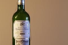 Fangyi_Fan_wine_bottle_green_still_object