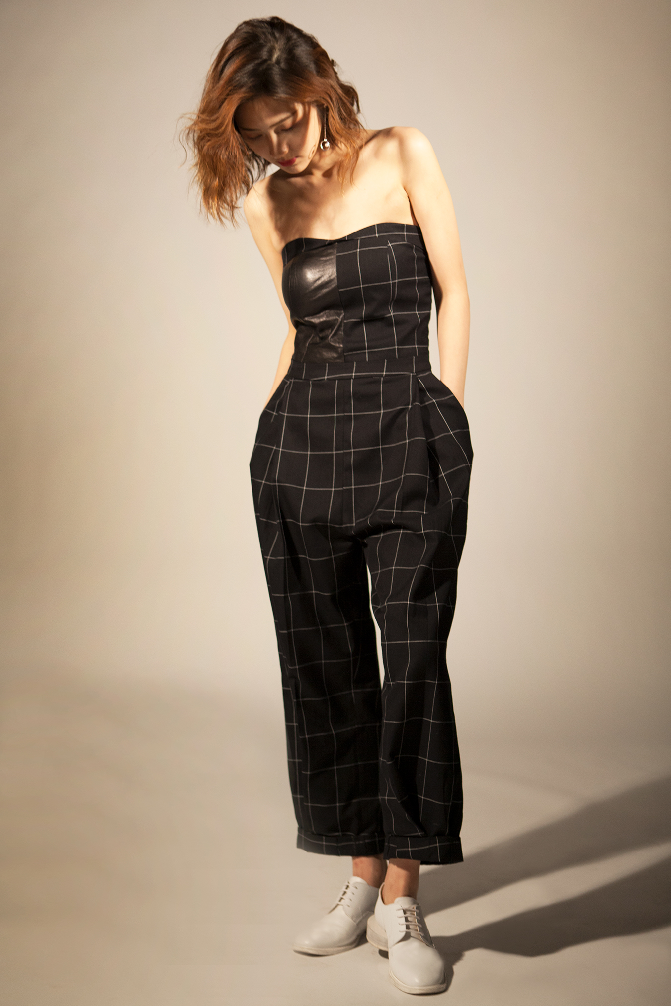 studio_black_checked_jumpsuit_looking_underneath