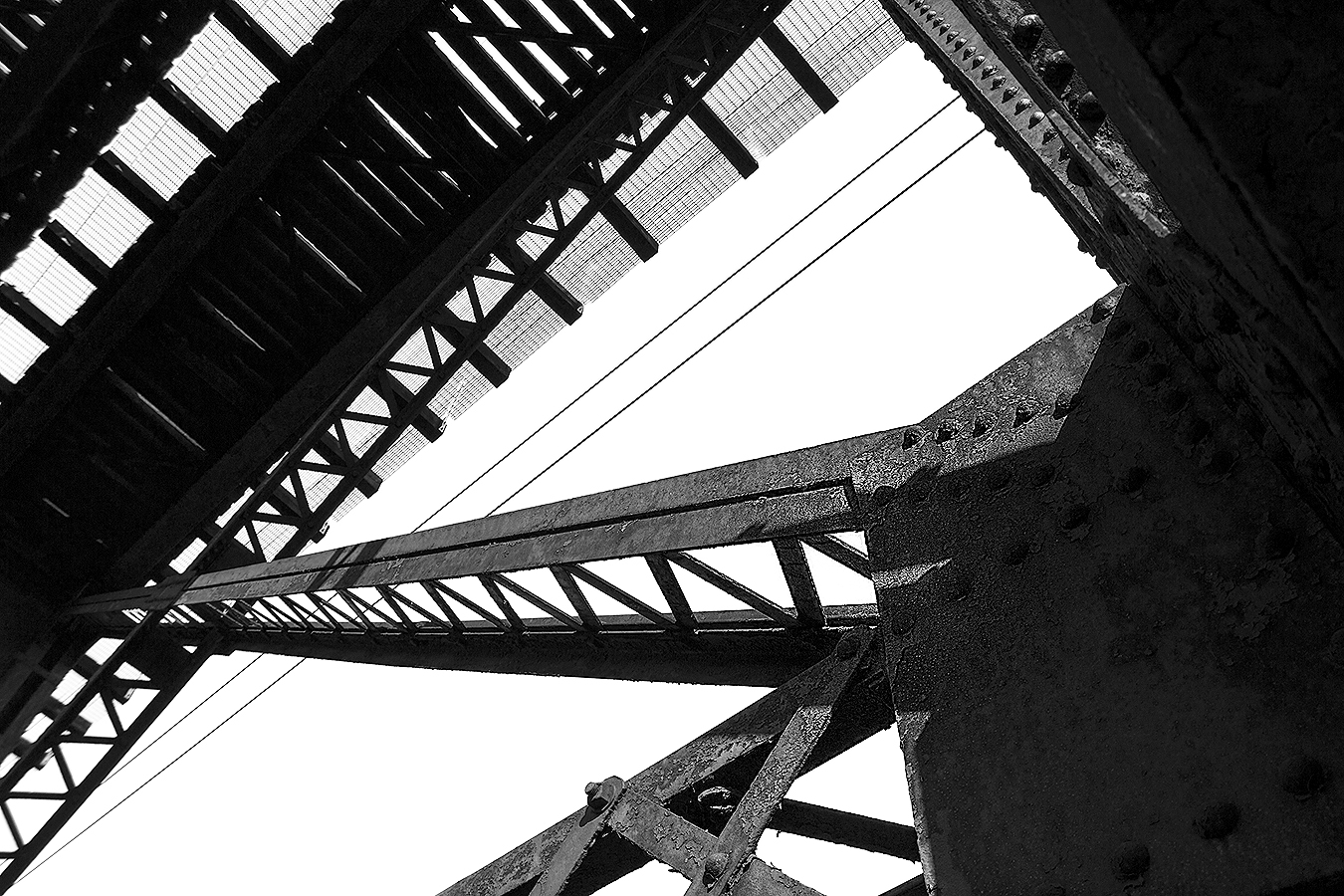 Janelle_Tong_Photography_Tony_Ward_Studio_Individual_Project_UPenn_Penn_Park_Bridges_Railroad_Tracks_Underneath_Rust_Structure_Black_and_White_4