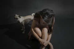 Karen_Liao_portraiture_photography_studio_lighting_sadness_dog_pug_ground_look_down