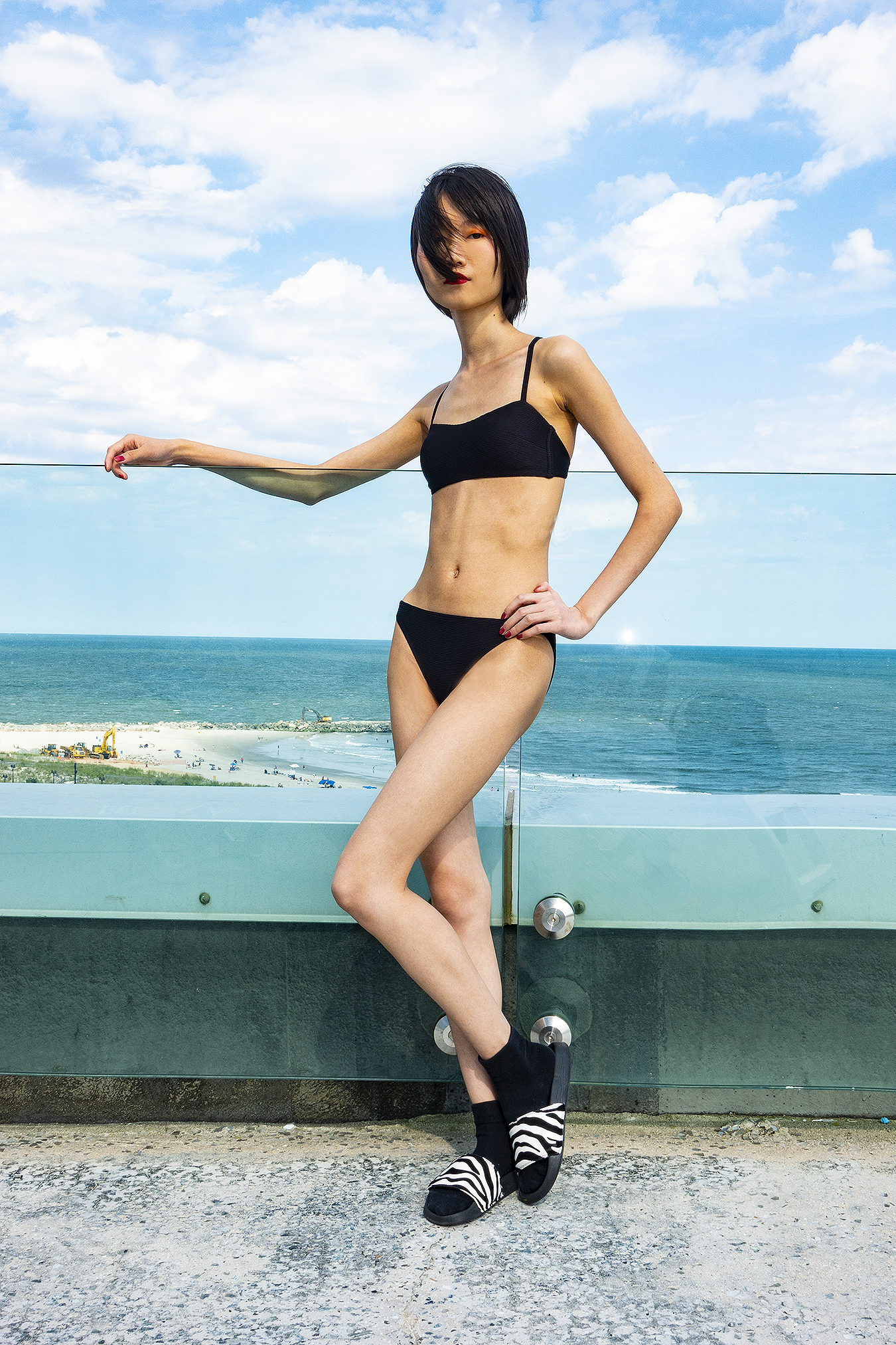 Tony_Ward_Studio_portrait_Linda_Ruan_black_bathing_suit_fashion_ocean_view_rooftop