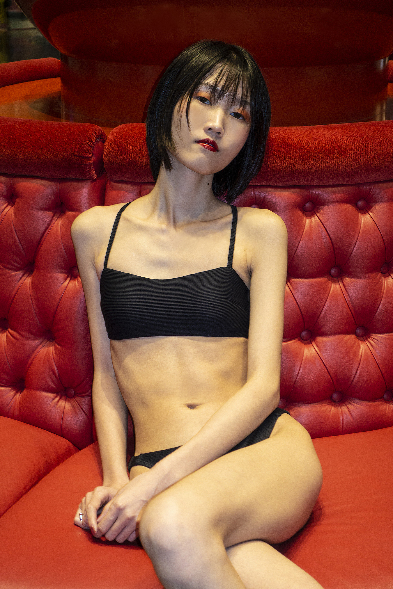 Tony_Ward_Studio_portrait_Linda_Ruan_black_bathing_suit_fashion_red_sofa_Ocean_Casino_AC