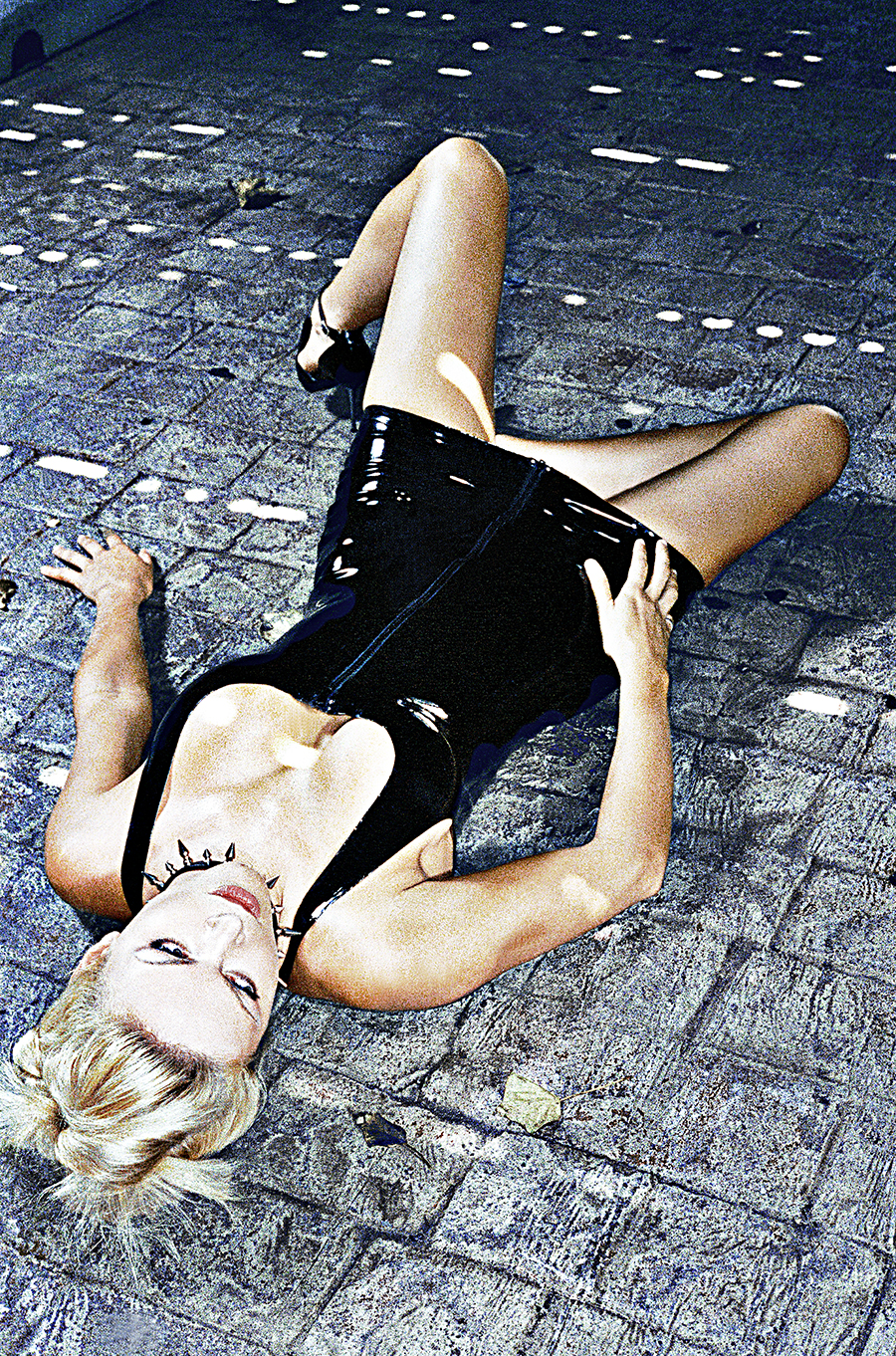 Tony_Ward_erotic_fetish_photography_latex_dress_stone_pavement_collar_blond_model