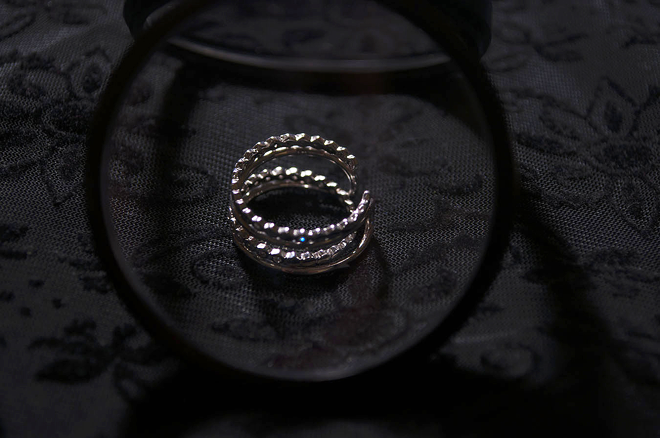 Rebecca_Huang_still_life_photography_dark_velvet_accessories_rings_jewelry_lens_magnifying_reflection_silver_honeycomb_jewels_floral_stacked