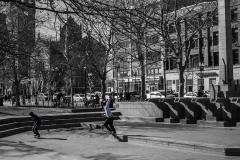 Rebecca_Huang_Boston_Boston_Public_Garden_skateboarding_skate-boarders_tricks_open theater area_selective_black_and_white_color