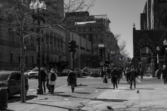 Rebecca_Huang_Boston_Copley_Square_tourist_walking_street_signs_selective_black_and_white_color