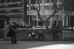 Rebecca_Huang_Philadelphia_Rittenhouse_Square_Sitting_around_little_boy_games_playing_after_school_selective_black_and_white