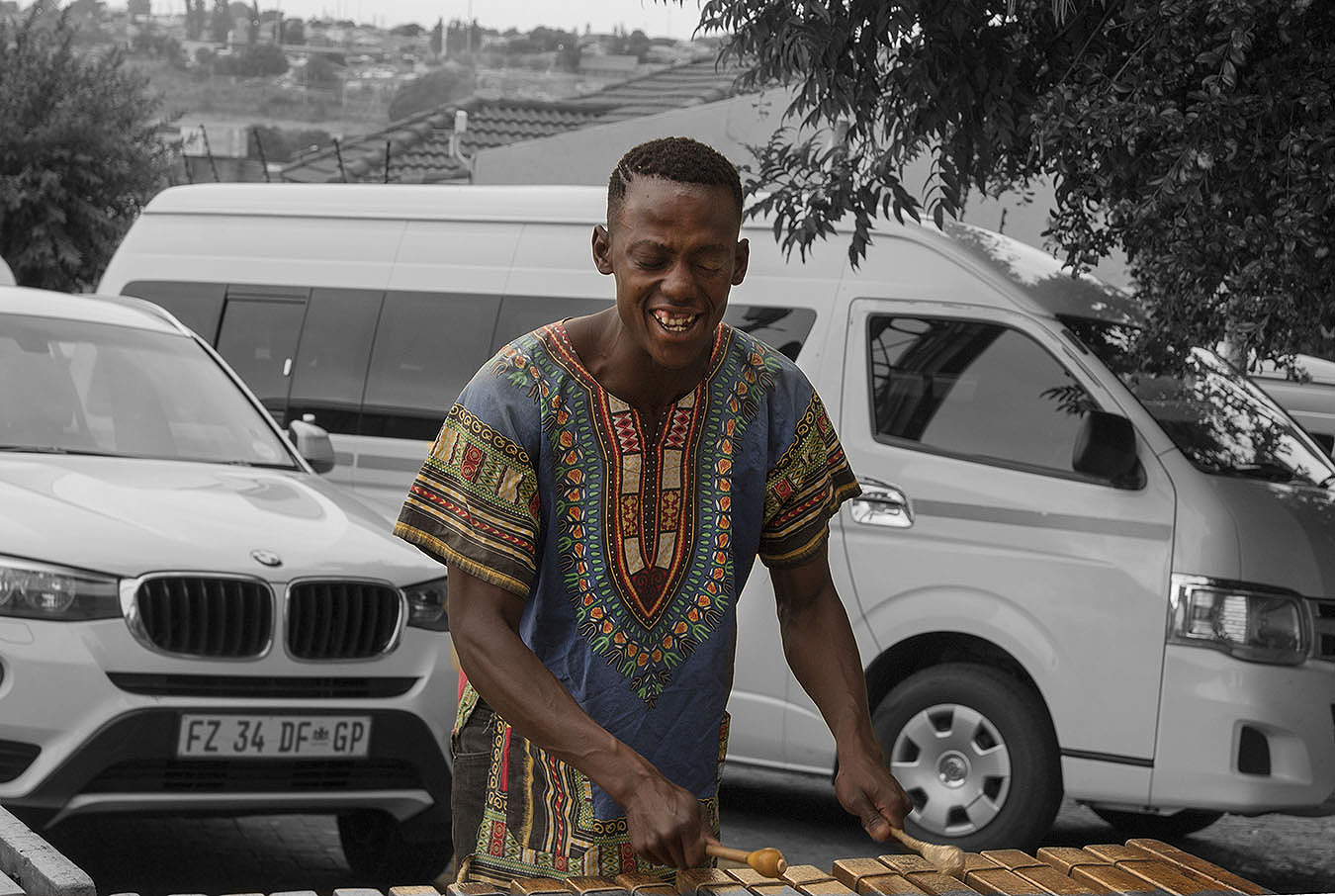 A local South African playing music on the road
