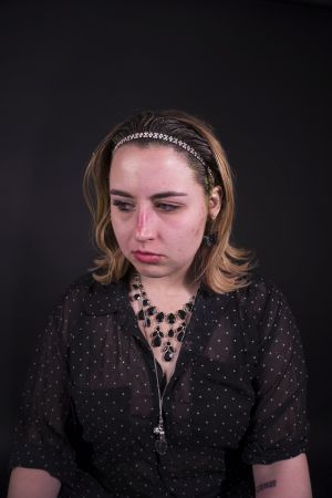 Kelly_Ha_Photography_Upenn_Penn_faces_front_face_Portraiture_portrait_makeup_young_womenkatie_eyes_closed_necklace_jewelry_katie_face_makeup_side_lipstick_katie_looking_down.jpg