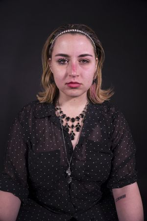 Kelly_Ha_Photography_Upenn_Penn_faces_front_face_Portraiture_portrait_makeup_young_womenkatie_eyes_closed_necklace_jewelry_katie_face_makeup_side_lipstick_katie_lookingstraightforward.jpg