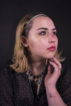 Kelly_Ha_Photography_Upenn_Penn_faces_front_face_Portraiture_portrait_makeup_young_womenkatie_eyes_closed_necklace_jewelry_katie_face_makeup_side_lipstick_katie_makeupside_hand.jpg