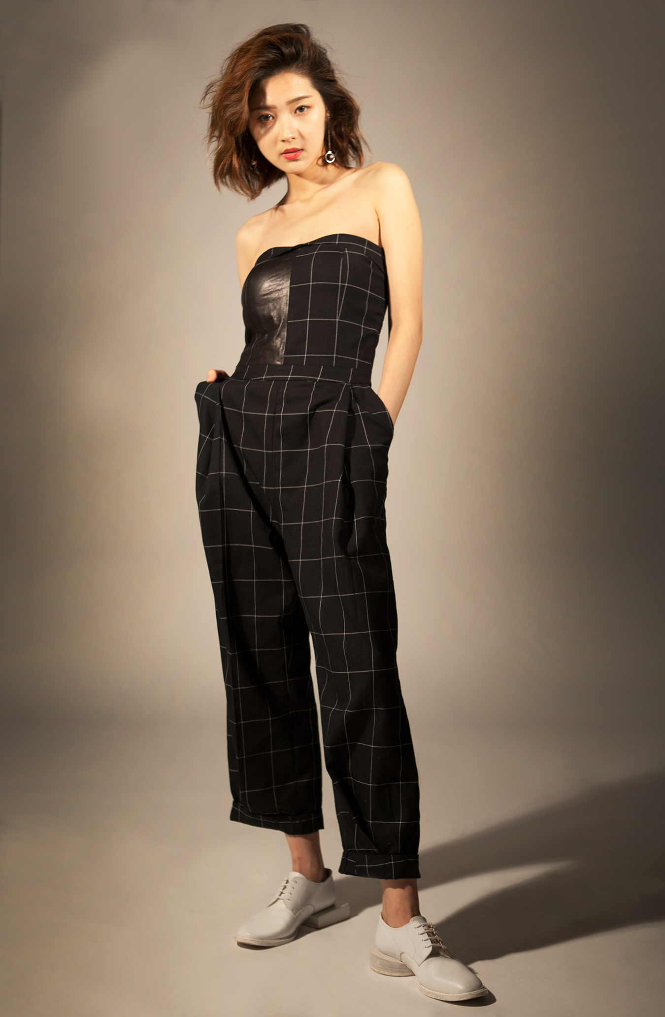 studio_black_checked_jumpsuit_looking_straight