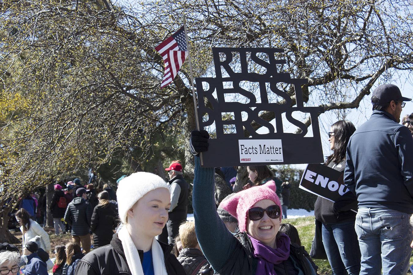 Hilary_Lam_Hugs_not_guns_protestor_philadelphia_Rise_Resist_Persist