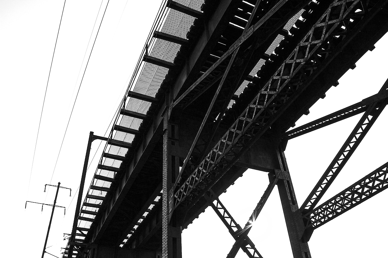 Janelle_Tong_Photography_Tony_Ward_Studio_Individual_Project_UPenn_Penn_Park_Bridges_Railroad_Tracks_Underneath_Rust_Structure_Black_and_White_3
