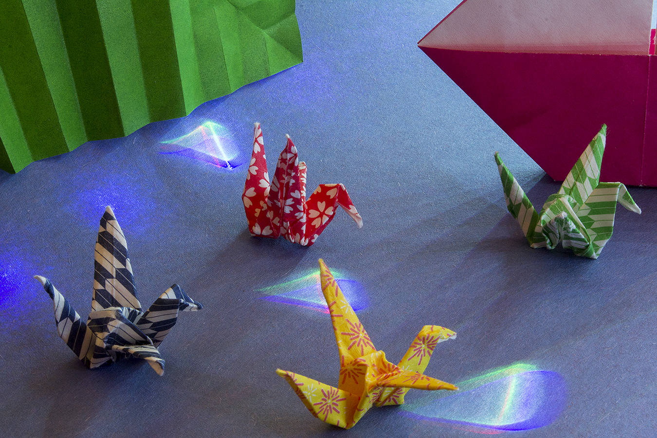 23_Gems_Jonathan_Tang_UPenn_Tony_Ward_Studio_Long_Exposure_Low_Light_LED_Optics_Origami_Paper_Sea_Leaf_Boat_Cranes