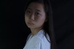 Karen_Liao_portraiture_photography_studio_lighting_despair_blue_looking_over_shoulder