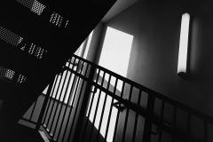 Linda_Ruan_depressed_girl_black_white_chirascuro_angular_stairwell_graphics