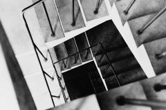 Linda_Ruan_depressed_girl_black_white_chirascuro_stairwell_graphic_railing