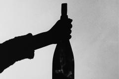 Linda_Ruan_depressed_girl_black_white_chirascuro_wine_bottle_silhouette