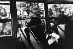Linda_Ruan_depressed_girl_black_white_chirascuro_woman_texting_bus