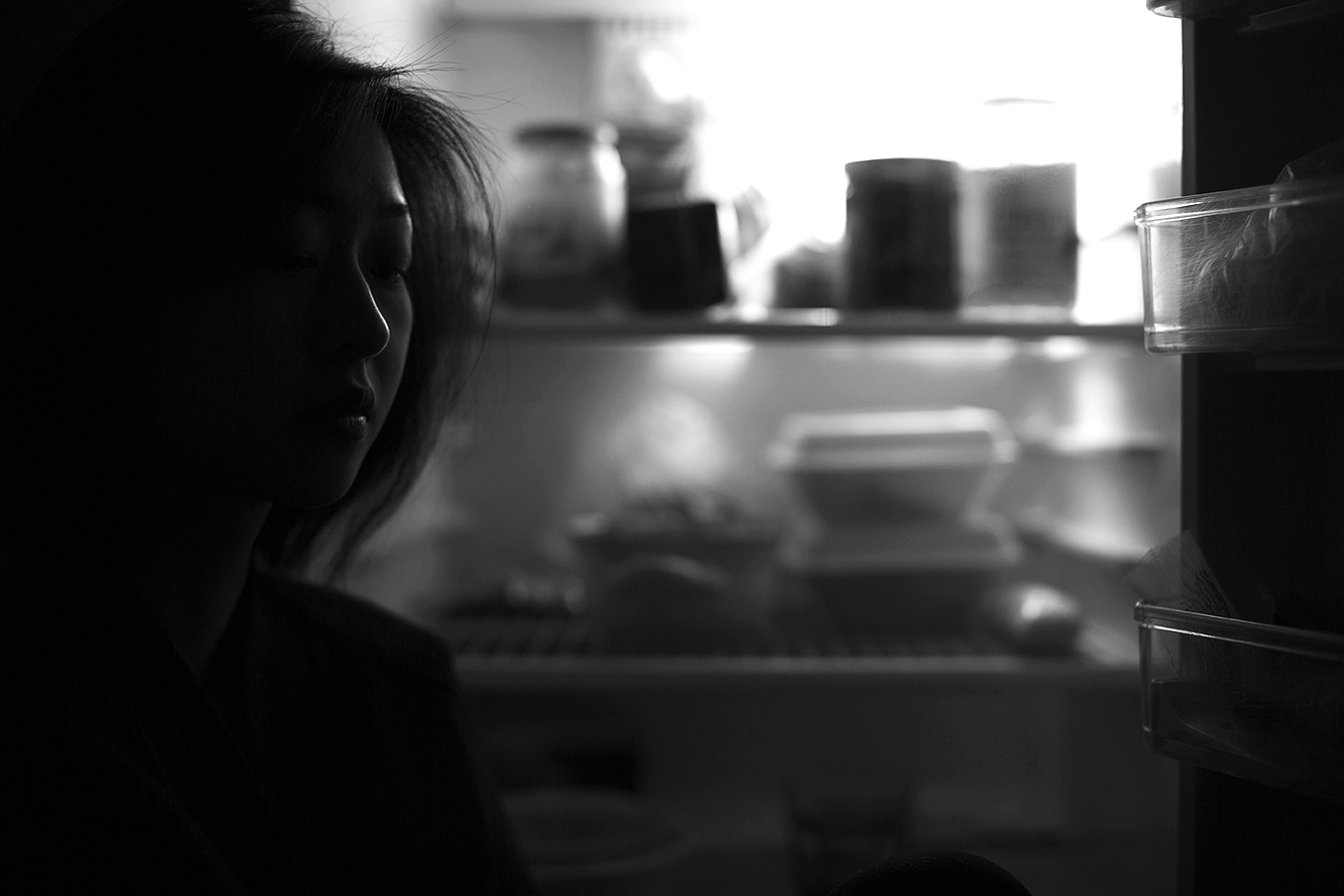 Linda_Ruan_in_front_of_a_refridge_black_and_white