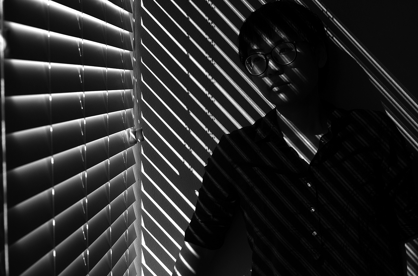 Linda_Ruan_through_the_window_shade_light_and_shadow_black_and_white