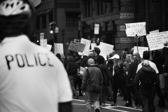 Noel_Zheng_photography_student_upenn_university_of_pennsylvania_Tony_Ward_Studio_Philadelphia_photojournalism_new_propaganda_black_and_white_President_Trump_protest_march_tax_refund_return_police