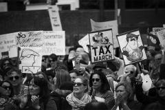 Noel_Zheng_photography_student_upenn_university_of_pennsylvania_Tony_Ward_Studio_Philadelphia_photojournalism_new_propaganda_black_and_white_President_Trump_protest_march_tax_refund_return_posters_protesting_crowd_creating_a_movement