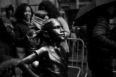 Noel_Zheng_photography_student_upenn_university_of_pennsylvania_Tony_Ward_Studio_New_York_City_travel_photography_black_and_white_snow_fall_fearless_girl_wall_street_lower_manhattan_women_rights_feminist_equality_umbrella