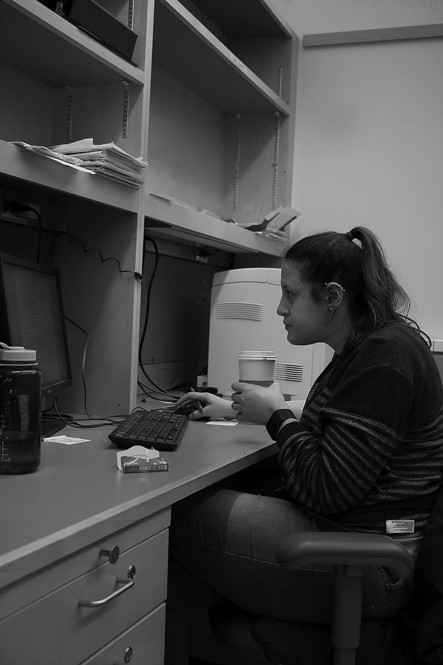 Tyler_Ling_photography_laboratory_computers_working_determined_absorbed_coffee_student_Penn_sideshot_unaware_black_white