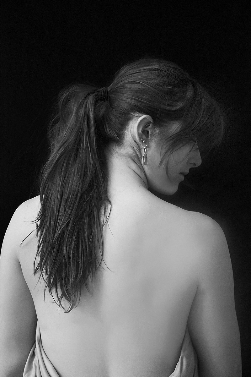 photo of young woman's back with side profile