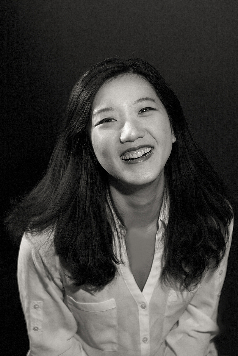 Portrait of happy young Asian woman