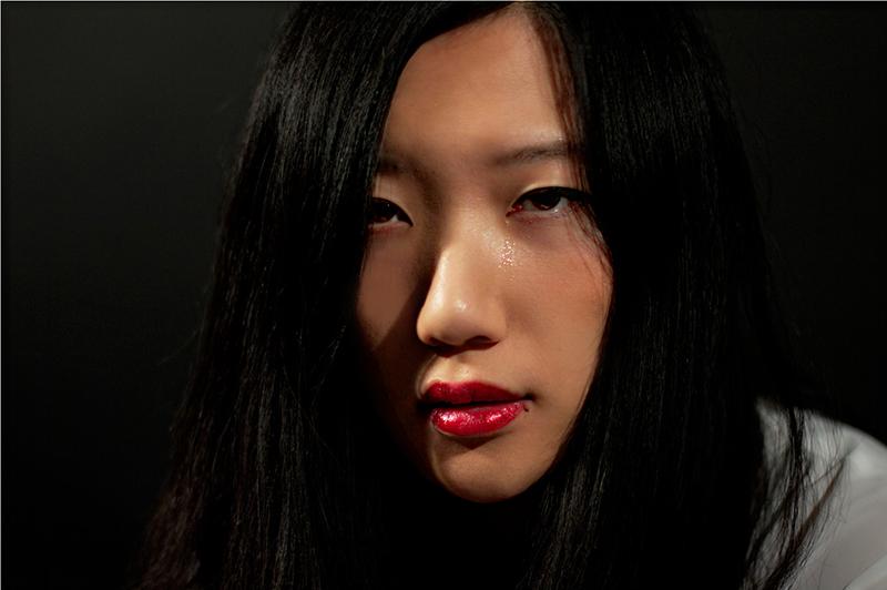 beautiful asian girl in tears