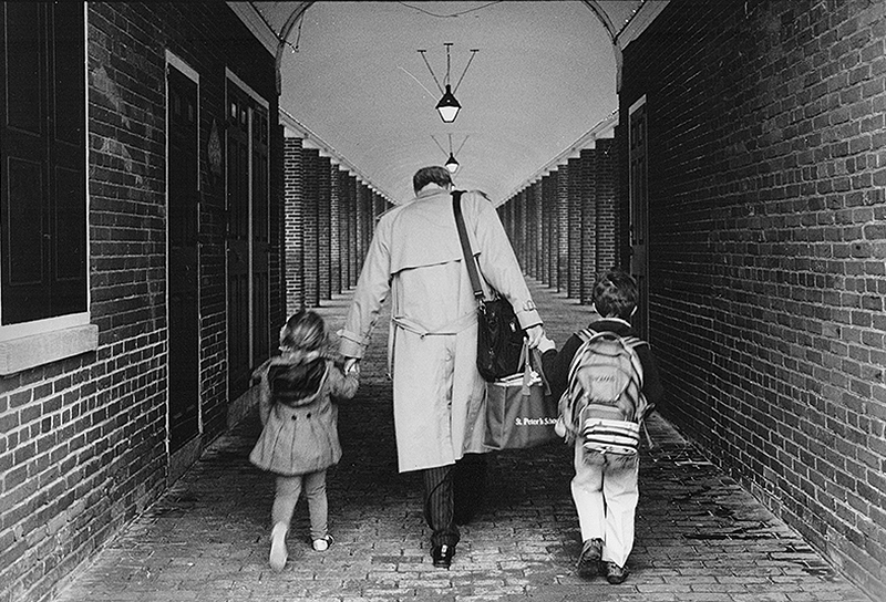 father walking his kids to school Philadelphia's Head House Square