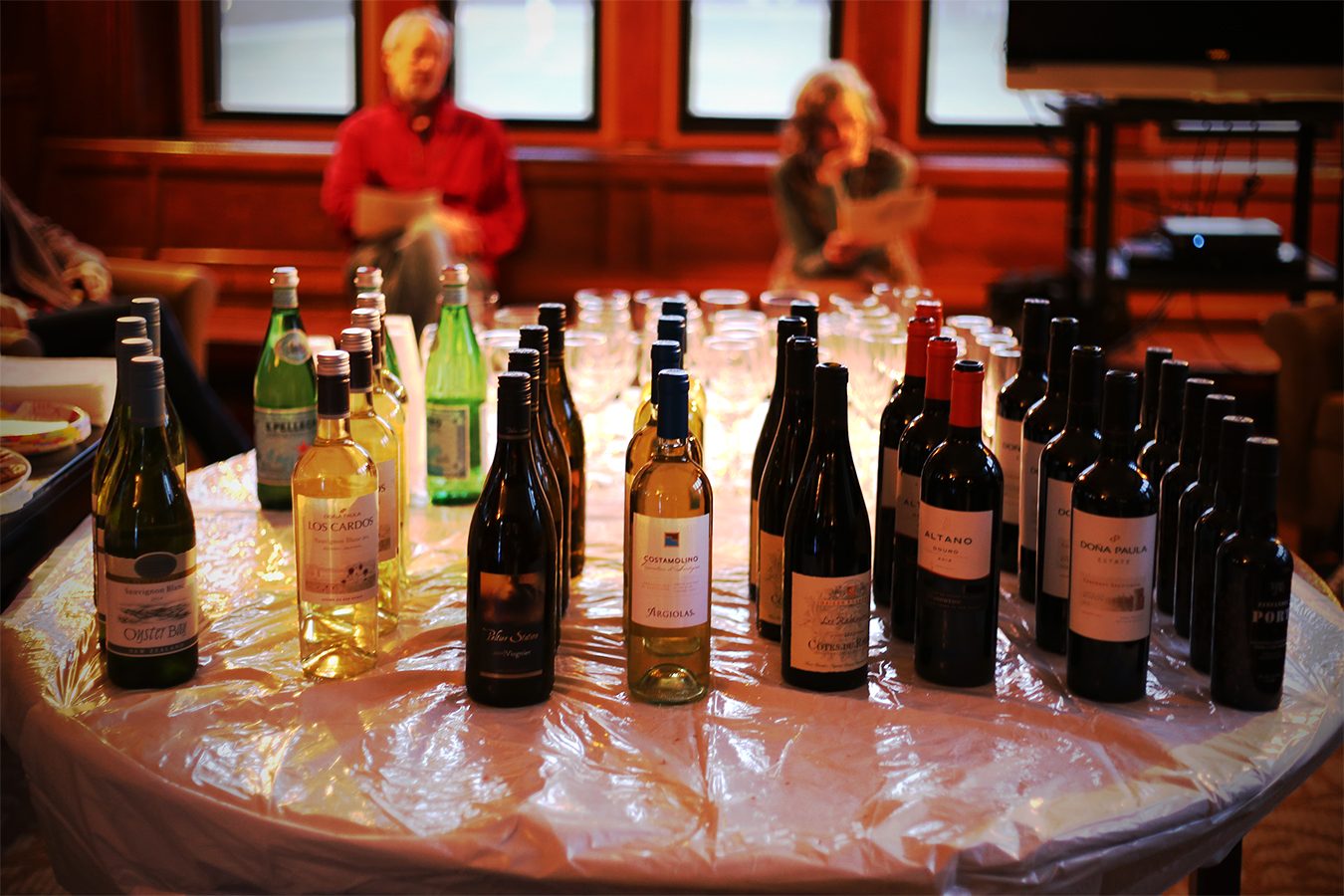 While most seniors in college are still struggling with their thesis and looking forward to all the senior week activities and graduation, psychology major students are the group who people are jealous of because we are always the one who starts our own celebration first.  Every year, psychology department would hold a wine tasting event for seniors a month before the graduation. The interesting part of the wine tasting night is, not only you get to taste different red and white wines that brought from the faculties, enjoy the cheese and food throughout the night, but also you get a chance to win free bottles of wine at the end of the night. Every faculty from the psychology department would pick a bottle of wine they like but the students would not know who bring what wine. The rule of the game is that the students would get a paper which include the description of each wine which includes the taste of the wine and why that person like it. After tasting, students need to match the wine with the faculties. The person who guesses the most right would get to take the free bottles of wine home.  it was a really fun night. Professors got to share their life and interests with the senior students. The competition was intense and students communicated a lot about their own ideas of each professor's taste like. Apparently, I wasn't able to capture the winner of the night, since she is busing taking photos the whole time!