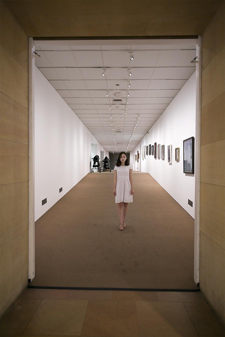 Xiaojun_Tian_Fashion_Photography_Assignment_2_PMA_HallwayWithWhiteWalls_WhiteDress_2_XiaoyeJiang