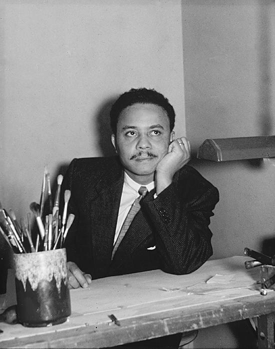 Milt Ward graphic designer at his desk circa 1955 Elkins Park Pa