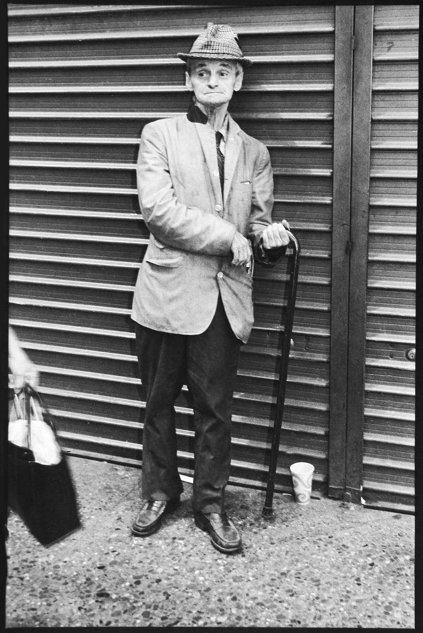 Tony_Ward_Studio_early_work_homeless_man_with_can_cup_begger